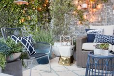 """Take it outside – Target patio makeover (""""Layer with potted plants. Plants are the room divider of your patio. They help create intimacy and privacy as well as add to texture and life, obviously."""")"""