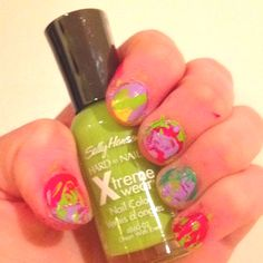 For these artsy nails, just paint your nails different colors and use a toothpick to mix other colors around!