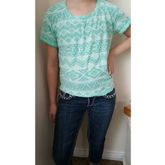 Daytrip shirt Turquoise and white daytrip shirt. Size runs a little big, it's an XS but fits like a S or M. Very flattering and is super cute with a necklace or cardigan. Daytrip Tops Tees - Short Sleeve