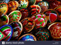 North America, Mexico, State of Guerrero, Acapulco. Colorful wooden bowls hand painted with traditional designs. Stock Photo