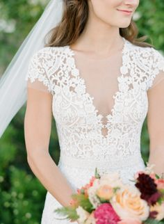 Short Sleeve Lace Wedding Dress with a Plunging Neckline | Ruth Eileen Photography | http://heyweddinglady.com/playful-elegance-pastel-peach-pink/