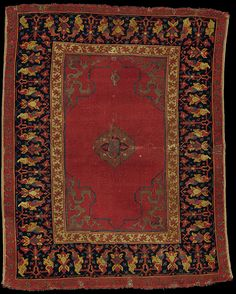A small medallion Ushak rug West Anatolia, Circa 1600  Approximately 4 ft. 10 in. x 3 ft. 11 in. (147 cm. x 119 cm.)
