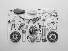 disassembled motorcycle arranged neatly