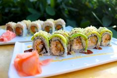 Perfection Roll - Crispy shrimp, cream cheese and real crab salad, topped with avocado and tempura flakes, garnished with spicy mayo and eel sauce.