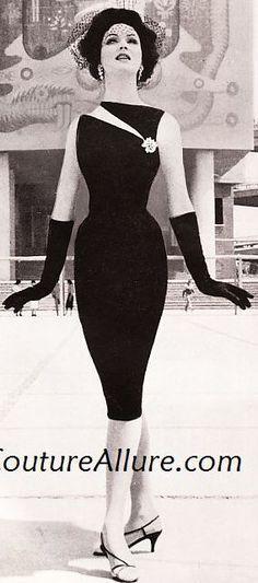 1960 Betsy Pickering in black cocktail sheath with slashed tabletop neckline by Estévez