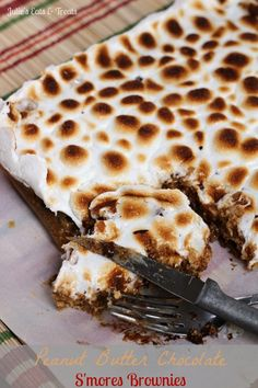 Peanut Butter Chocolate Smores Brownies ~ Peanut Butter Blondies sandwiched between Graham Crackers and topped with Toasted Marshmallows and Chocolate Chips via www.julieseatsandtreats.com