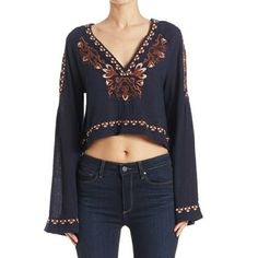 REDUCEDNWT FREE PEOPLE Embroidered Top Size S! NWT FREE PEOPLE High Times embroidered cropped top in color indigo! Cropped to the natural waist, this lightweight semi-sheer top features a silhouette reminiscent of decades past. With an allover embroidery detailing, V-neckline, and statement bell sleeves. Reasonable offers considered. BUNDLE AND SAVE!  52% Cotton 48% Viscose Machine Wash Cold Free People Tops Crop Tops