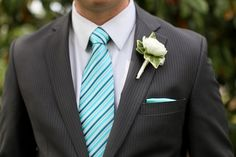 teal & blue striped tie and pinstriped suit on the groom from Amanda & Sonny's vintage garden wedding in Maryland. Images via Megan Beth Photography.