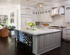 The island paint color is Sherwin Williams Mindful Gray 7016; the white cabinets are Sherwin William Pure White 7005.