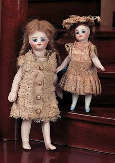 """View Catalog Item - Theriault's Antique Doll Auctions two french all bisque dolls in original costumes, 6"""" and 3.5"""""""