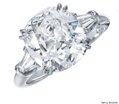 """The """"Chuck & Blair"""" Harry Winston cushion engagement ring. I may want a bit more 'antique' detail somehow, but this is lovely. Maybe longer, thinner baguettes as well? In love with love. #Harrywinston #engagementring #ring cushion cut diamond in a tapered baguette setting"""