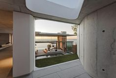 The Family room, placed on the mountain side of the courtyard garden, provides for cocooned living while the double volume Living and Dining area on the sea side is more dramatic, with its rippling concrete feature fireplace wall and commanding views. http://bocadolobo.com/blog/architecture/
