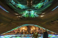 """""""Luminous Field"""" - A 10 day art installation that included video / projection mapping on the Cloud Gate sculpture (aka """"The Bean"""") in Chicago's Millennium Park.  View from the underside of the sculpture.  Artist - Luftwerk;  Equipment & technical support provided by AV Chicago.  (Photo by Ken Illio)"""