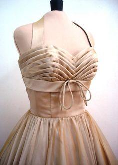 A chiffon 50s cocktail dress in almond custom. $265.00, via Etsy.