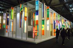 An exhibition stand with loads of cropped flag light boxes.