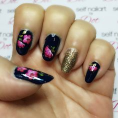 Dark blue nails with gold glitter accent nail. Floral water decal nailart