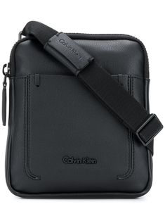 Shop designer messenger bags for men at Farfetch. Choose from brands including Gucci, Prada, Burberry and more. Designer Messenger Bags, Messenger Bag Men, Calvin Klein Men, Calvin Klein Black, Burberry, Gucci, Logo Stamp, Embossed Logo, Fashion Styles