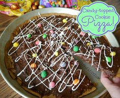 This delightful candy topped cookie pizza can be made with anything and everything! I had never made a cookie pizza before, so I was winging it, and my directions are going to sound like it. Sorry! But when I found myself surrounded with the most wonderful selection of Nestle Easter candy, I just couldn't resist …