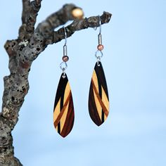 These wonderful handcrafted feature exotic light weight woods and eye catching accents. This brilliant pairing of some of nature's most beautiful and intricate materials has made these earrings a must have in your jewelry collection. https://earthwoodfiber.com/Product/Small-Wood-Oval-Earrings-Handcrafted-From-Ebony-Birds-Eye-Maple-Koa--Pau-Brasil