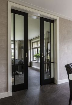 Pocket doors or sliding doors with black trim to offset the rest of the white trim and white fireplace. French Pocket Doors, French Doors, Glass Pocket Doors, Glass Entry Doors, Glass Office Doors, Glass Barn Doors, Entrance Doors, Door Makeover, Black Doors