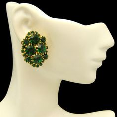 STRIKING GREEN RHINESTONE CLIPS! Classy vintage clips with large and small prong-set green rhinestones. Beautiful color! See More Great Vintage Earrings in My Shop:https://www.etsy.com/shop/MyClassicJewelry?section_id=13113950