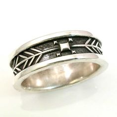 Mens Arrow Tail Ring - Sterling Silver - Native American South Western    This ring makes me think of a an abstract arrow and a bulls eye. My