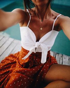 White tie front crop cami and rusty red flowy skirt with small white polka dots