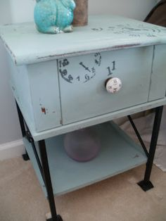 painted end table. SOLD - This end table / night table has been painted using ASCP duck egg blue and black clocks have been added to give it an old world look.  The one drawer has black and white wallpaper.