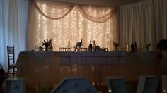 Top table set up on stage of main hall