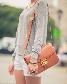 Gray Long Sleeve. White Shorts. Chestnut Leather Purse.