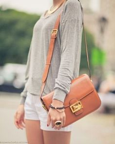 Gray Long Sleeve. White Shorts. Chestnut Leather Purse.