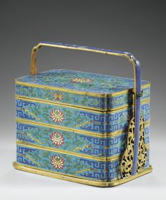 A RARE LOTUS CLOISONNÉ ENAMEL TIERED BOX AND COVER, QING DYNASTY, QIANLONG PERIOD (1736-1795)