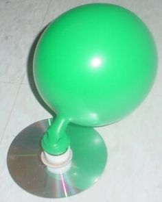 Photo shows the Hovercraft Racer activity set-up: a balloon attached to (and above) a compact disc, causing the CD to slide across a linoleum floor.