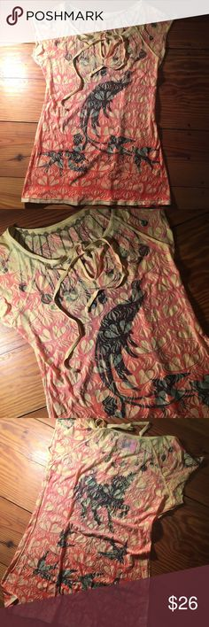 Gorgeous Colorful T-shirt This soft t-shirt has beautiful graphics all over it with exposed rough sewn edging and a string tie at the scoop neck. Gorgeous peacock on the front with birds and loads of fun colors. A piece of art! butterfly dropout Tops Tees - Short Sleeve