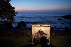 Luxury Oceanfront Dining Illuminated by Chandelier Light - Bliss Wedding Design - Kukahiko Estate - Destination Wedding - Anna Kim Photography