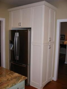 Cabinets like this might work around the lonely refrigerator