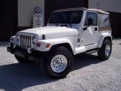 """1998 Jeep Sarhah Motor: 6 cyl Price: $9,500.00 Description: 4x4, 5 spd, new best softtop and full steel doors, new 16"""" alum wheels and 31"""" tires, new GM store trade."""