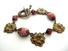 Vintaj Repousse Flower Beaded Bracelet. http://beadinspirations.com/vintaj-brass-flower-pendant-connector-p70-p-1934.html
