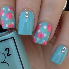 Blue floral themed nail art design. This nail art uses light blue polish is used as the base color with pink and white rose details on top.