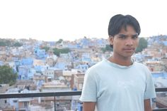 Young boy on the roof top of Singhvi's Haveli, Jodhpur, India