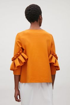 COS image 18 of Top with frill detailed sleeves in Orange