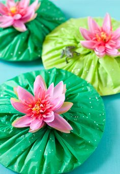 Here's a cute and easy way to make lily pads: Wrap green plastic or tissue paper around a paper plate. Tie the plastic/tissue together in the middle and stick a fake flower over the top. Ad…
