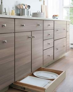 A toe-kick drawer fits beneath cabinetry, adding extra storage, and is perfect for housing large plates and platters. Like storage n toe kick drawer Tidy Kitchen, Kitchen Tops, Kitchen Redo, New Kitchen, Kitchen Remodel, Kitchen Ideas, Design Kitchen, Kitchen Drawer Organization, Kitchen Drawers