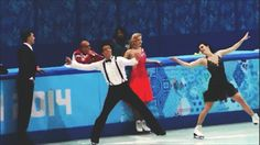 Scott Moir improvises and blows Dmitri Soloviev a kiss during a practice before the short dance in Sochi.