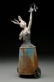 Kristen StingleI combine found objects and discarded elements from the past with my ceramic work. The mixed media not only creates an intriguing dialogue of materials but also informs the viewer of the scope of the figure's journey within each narrative.