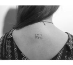 Cute elephant tattoo on neck