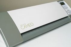 $299 Silhouette Cameo... Electronic cutting tool that is simple to use. It hooks up to your computer and with the help of the Silhouette Studio (a free software provided by the machine maker) you can cut purchased files or make your own. I like that the machine is clean in design (not pink or girly) and that it's fairly small (smaller than a Cricut).