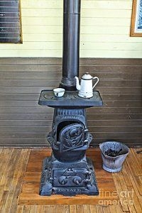 Old Stoves Photograph - Old Cast Iron Stove 2 by Jimmy Ostgard