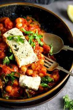 Baked Feta in a Spicy Tomato Sauce with Chickpeas and Spinach | The Last Food Blog #bakedfeta #vegetarianrecipes #vegetarianmeals