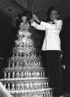Vintage champagne tower - New Years Eve Party. See more New Years Vintage Party Images and Advertising at the www.vintageinn.ca blog #newyearseveparty #newyears #vintagephotography
